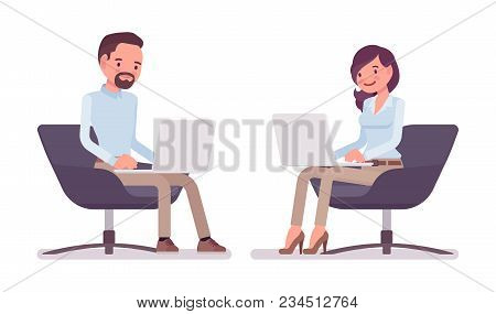 Smart Middle Aged Man, Young Woman In Buttoned Up Shirt, Camel Skinny Chino Trousers, Sitting With L