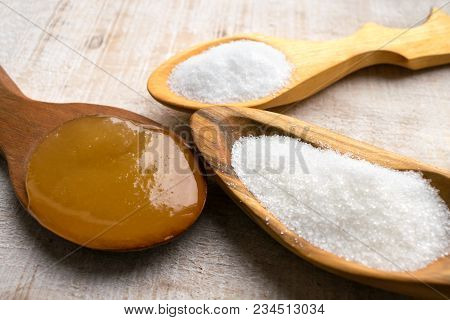 Artificial Sweeteners And Sugar Substitutes In Wooden Spoons. Natural And Synthetic Sugarfree Food A