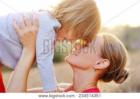 Portrait Of A Mother Holding Her Daughter With Tenderness