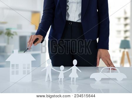 Cut outs of insurance with woman in bright room