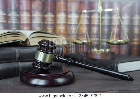 Wood Gavel, Soundblock, Scales And Open Old Book Against The Background Of A Row Of Antique Books Bo