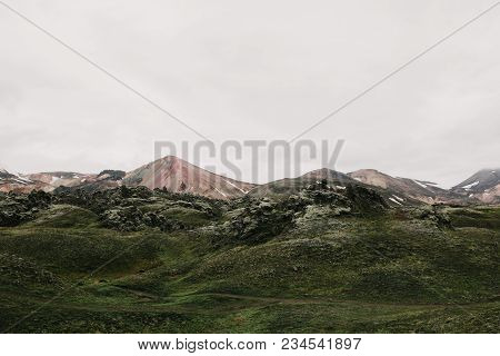 Beautiful Scenic Icelandic Landscape With Hills And Green Vegetation