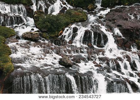 Beautiful Waterfalls On Rocks And Green Vegetation In Iceland