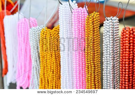 Colorful Multicolor Beaded And Artificial Pearl Necklace Hang On A Steel Hook To Sell On Street Mark