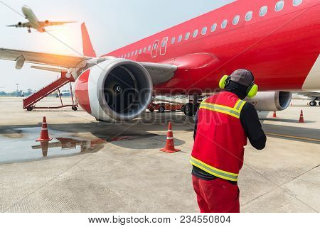 Technicians In Signal Vests Prepare The Aircraft For Flight. Inspection And Maintenance Of The Aircr