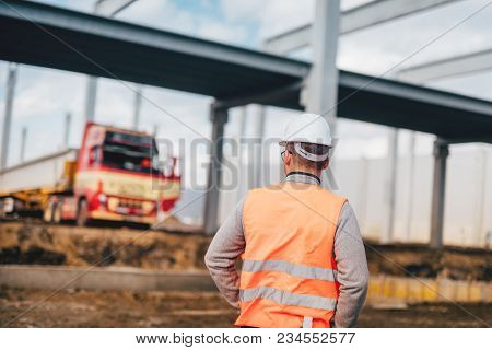Engineer Working On Construction Site, Working With Machinery And Excavators, Managing Building Site