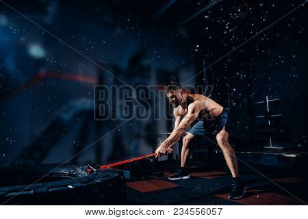 Sports Training For Endurance, Man Hits Hammer With Heavy Hammer, Sledge Hammer. Concept Workout