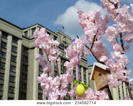 Easter In Moscow. Spring Easter Decorations Against The Building Of The State Duma Of Russia (russia