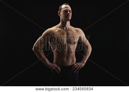 Strong Athletic Man, Bodybuilder. Naked Torso, Muscular Body. Strong Chest And Shoulder Muscles. Stu