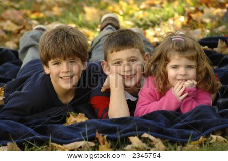 Kids In Fallen Leaves