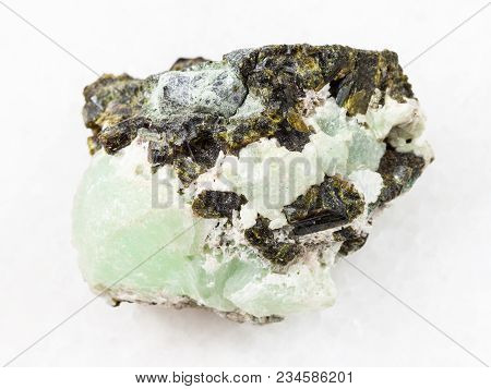 Macro Shooting Of Natural Mineral Stone Specimen - Epidote Crystals On Prehnite Gemstone On White Ma