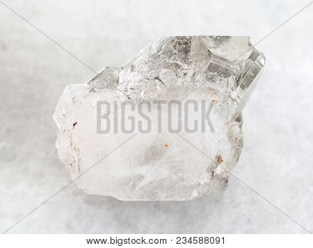 Macro Shooting Of Natural Mineral Rock Specimen - Rough Rock-crystal Of Quartz Gemstone On White Mar