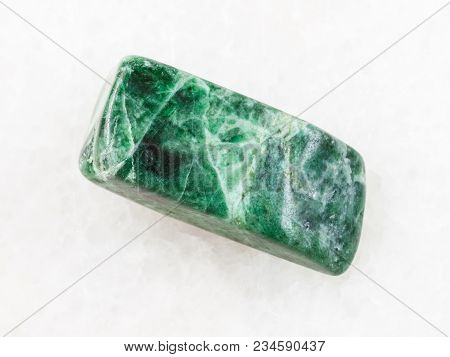 Macro Shooting Of Natural Mineral Rock Specimen - Tumbled Green Jadeite Stone On White Marble Backgr