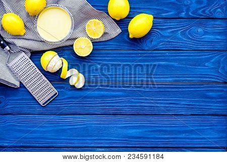 Cook Lemon Curd. Sweet Cream In Bowl, Fruits, Kitchen Utensils Grater On Blue Wooden Background Top