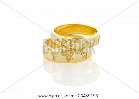 World Map Golden Wedding Rings Isolated On White Background. Travel Lovers Newlyweds. Honeymoon Conc