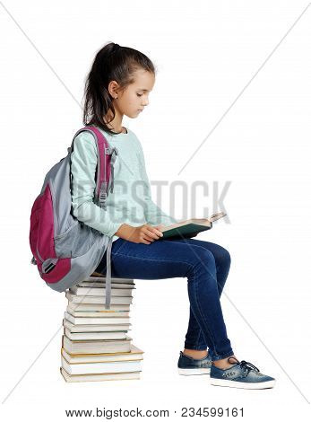 Schoolgirl Reading The Book On The Pile Of Book S Isolated On White
