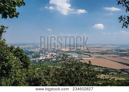 Lovosice City With Agricultural Landscapea Round With Fields, Villages, Roads And Small Hills On The