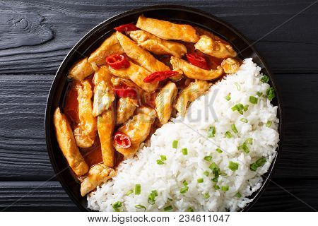 Chicken Panang Curry With Garnish Of Rice Close-up. Horizontal Top View From Above