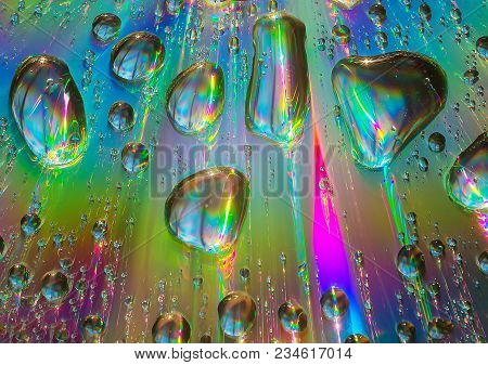 Water Drops On A Color Iridescent Background
