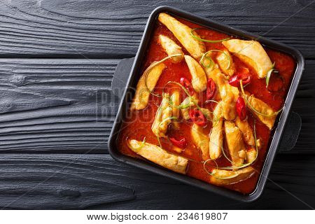 Spicy Chicken Pangang Curry Close-up On A Plate On A Table. Horizontal Top View From Above