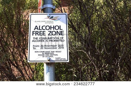 WEST WYALONG, AUSTRALIA – March 13, 2018:  Sign indicating an Alcohol Free Zone in which the driking of alcohol is prohibited twenty four seven - twenty four hours a day, seven days a week, in West Wyalong, New South Wales, Australia
