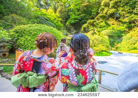 Kamakura, Japan - April 23, 2017: Japanese Women Wearing Japanese Traditional Kimono Take Photo With