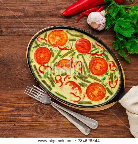 Scrambled Eggs  With A Medley Of Colorful Vegetables.  Beautiful Appetizing Dinner. Top View, Close-