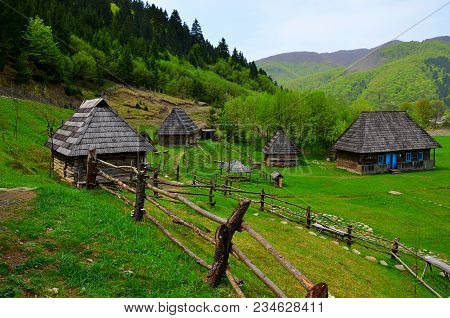 Old Wooden Houses. Traditional Old Wooden House In Carpathian Mountains. Dirt Road Leading To Lonely