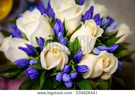 Wedding Bouquet Of White Roses And Blue Violet Fresia Or Hyacinth. Delicate White Gentle Roses And L