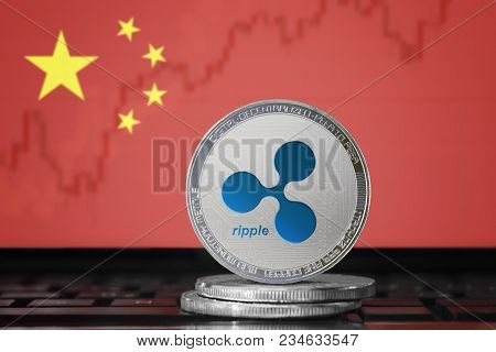 Ripple (xrp) Cryptocurrency; Physical Concept Ripple Coin On The Background Of The Flag Of China (pr