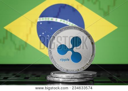 Ripple (xrp) Cryptocurrency; Physical Concept Ripple Coin On The Background Of The Flag Of Brazil