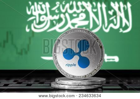 Ripple (xrp) Cryptocurrency; Physical Concept Ripple Coin On The Background Of The Flag Of Saudi Ara