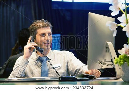 Hotel Administrator. A Male-reception Worker Accepts An Order For Booking A Room By Phone. Profile S