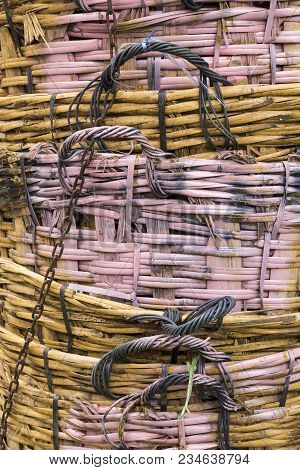 Background Of Texture Of Stack Big Bamboo Basket Weave With Pink Paint Color