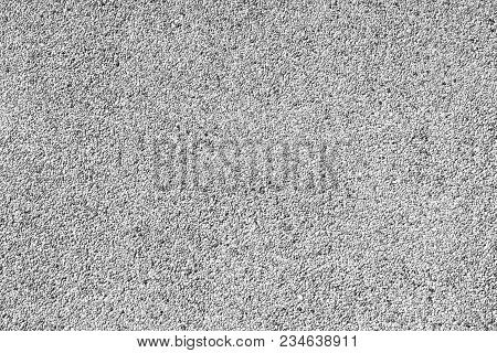 Background Of Fine Gravel Stone Wall In Black And White Tone