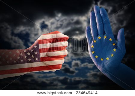 trade conflict, fist with USA flag against a hand with European flag, dramatic cloudy sky in the background poster