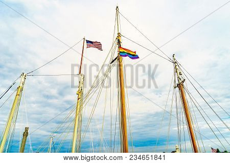 Two Flags On Yachts Masts In Provincetown' Marina, Massachusetts