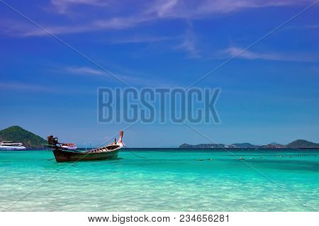 Landscape With Wooden Fishing Longtail Boat At Noon Tropical Sea. Seascape. Concept Of Aboriginal Li