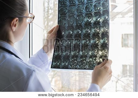Doctor Looks At The Picture Near The Window.