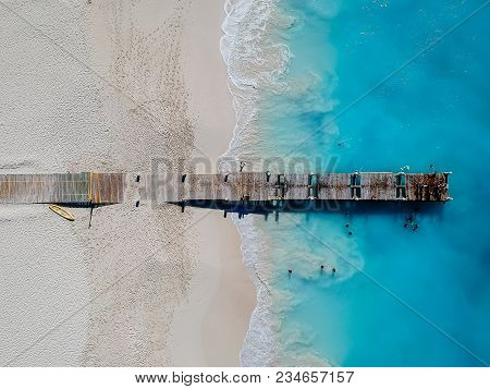 Drone Photo Of Pier In Beach In Grace Bay, Providenciales, Turks And Caicos