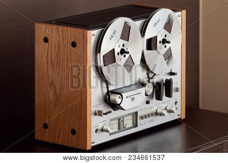 Vintage Open Reel-to-Reel Tape Deck Stereo Recorder Side Angled View