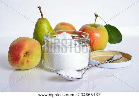 Fructose, Or Fruit Sugar In Glass Jar. With Fruit.