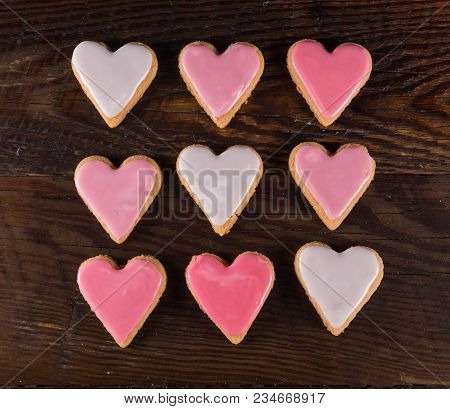 Nine Frosted  Heart Cookies In Grid With Gradients Of Pink Icing