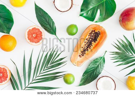 Summer Tropical Composition. Green Palm Leaves And Tropical Fruits On Gray Background. Summer Concep