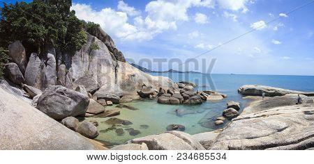 Tourists Exploring The Rocksy Coastline And Clear Sea Pools Near The Grandfather Rock On Lamai Beach