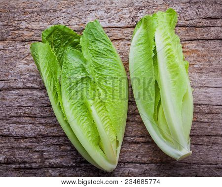 Food Background And Salad Concept With Fresh Cos Lettuce Flat Lay On Shabby Wooden Background.