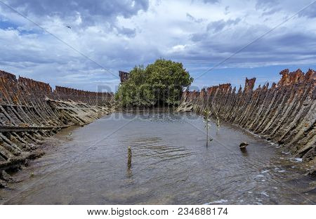 The Corroding Shell Of A Steel Hulled Ship Situated At Garden Island, Port Adelaide, South Australia