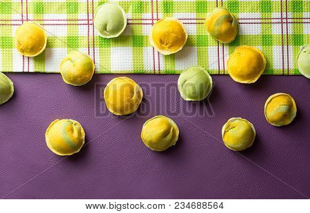 Row Of Homemade Raw Dumpling Green And Yellow Colors, Traditional East European Food Before Boiling.