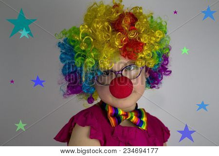 Little Girl In Clown Costume In Front Of  Background With Colorful Stars.little Girl With Glasses In