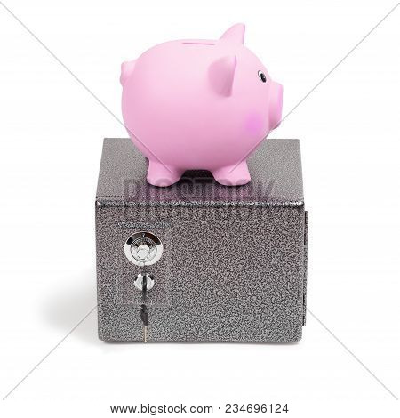 Pink Ceramic Piggy Bank Standing On A Safe, Isolated On White Background. Keeping Money In A Safe Or